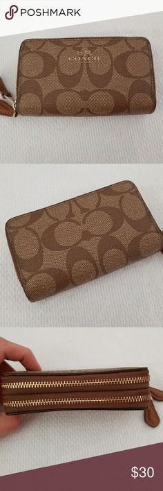 Coach wallet Authentic mini coach wallet fits your cards perfectly. Used but in great condition no scratches rips or tears. Comes with dust bag. Coach Bags Wallets