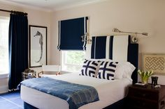 Nautical boy's room with a classic navy and white color scheme. Love the bed sconces and seahorse print!