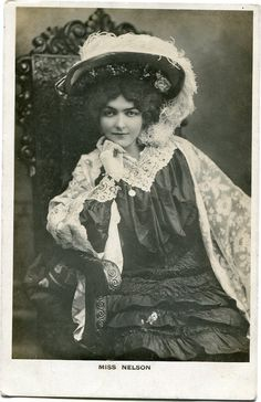 Brittish Edwardian stage star miss Nelson sitting in a chair - Vintage handtinted photo postcard - 1900s