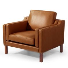 Børge Mogensen created the original 2211 for his own home in Gentofte Denmark in 1962. This premium quality reproduction of the item Club chair features a solid ash legs and hardwood frame graciously lined with polyurethane foam. The surface is luxuriously soft to the touch, compliments of its premium 100% top-grain aniline leather upholstery. The design goes a bit further than the classic mid century modern cube shape. The body has an airy feel about it as it suspends over 4 archi...
