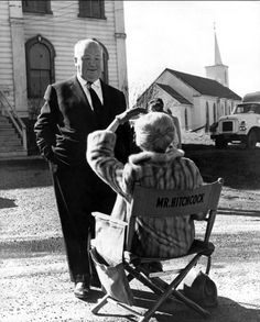 "Alfred Hitchcock and Tippi Hedren on the set of ""The Birds."""