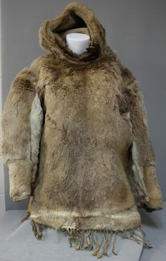 Today's fashion Friday is another fur piece. Donated by our first curator at The Huron County Museum Mr. J.H Neill, this beautiful Inuit Parka is made from deer skin with leather tassels on the bottom. Though the history of this artifact is vague, it's still a fantastic piece of history. To see artifacts like this and many other artifacts too, visit us at the Huron County Museum and Historic Gaol Huron County, Parka Jackets, Deer Skin, Leather Tassel, Tassels, Fur Coat, Friday, Beautiful Women, Turtle Neck
