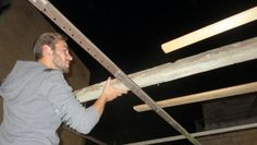 Guest at Heritage House doing a good job assembling a roof for the Sukkah.