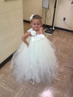 Flowergirl dress I made for my work daughter, 500 yards of tulle in ivory and silk flowers off the brides belt from wedding gown. So proud of myself of this dress for a special little girl and special bride.
