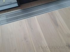 wide bleached oak boards with precise cut next to hidden radiators. Hardwood Floors, Flooring, Radiators, Boards, Wood Floor Tiles, Planks, Wood Flooring, Radiant Heaters, Floor