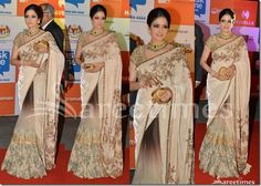 Bollywood and South Indian actress Sridevi in Sabyasachi saree at SIIMA 2014. She looked beautiful in tricolor embellished saree. Gold embellished applique patch and printed work all over saree,gold border. Paired with designer embellished short sleeves saree blouse. Heavy small embellished patch work all over blouse. Manish Malhotra Saree, Kareena Kapoor Saree, Sabyasachi Sarees, Bollywood Saree, Indian Bridal Sarees, Embellished Shorts, Sari Blouse Designs, Saree Trends, Saree Styles