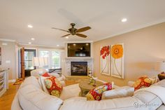 Transitional Living Room with metal fireplace, Ceiling fan, Hardwood floors, Crown molding, High ceiling, Carpet