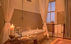 Kwandwe in the center of South Africa's malaria-free area near Grahamstown. The reserve is a member of the exclusive Relais & Chateaux portfolio. Game Reserve South Africa, Private Games, Corner Bathtub, Homesteading, Luxury Lodges, Master Bath, Bathroom, Places, Washroom