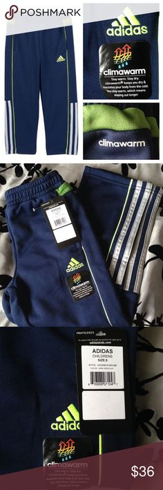 Adidas 'On The Ball' Climawarm Pants Brand new athletic pants for little boys. These cozy and breathable pants keep cold weather at bay with Climawarm technology. They are also moisture wicking. Features side pockets and elastic waist. Really cute navy, green, and gray color combo. Official color is dark indigo. Inseam is 17 inches. No trades. Adidas Bottoms