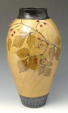 Tall amber vase red berries