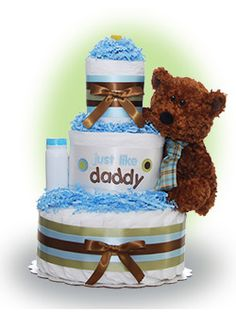 Just like Daddy - - A common phrase and one that all new dads love to hear. Make his day and send this cake to Daddy it will make him smile and provide him with diapers for the diaper changing experiences in his future. Only $67.00
