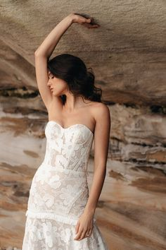 The Daisy Gown by Alena Leena Bridal is all statement style in macrame lace. Cotton trim accentuates your figure, and a corseted bodice offers support to emphasise your shoulders. Detailed cutouts add playful drama, and the overall style is perfect for the fun-loving bride-to-be.