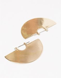From Tiro Tiro, a pair of polished half disk earrings in Brass. Features straight posts, thin silhouette and hook closure. • A pair of polished half disk earrings • Sterling silver ear wires • Brass • Straight posts • Thin silhouette • Hook closu
