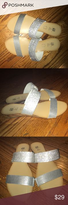 Silver Rhinestoned Sandals These beautiful sandals have never been worn. They need a new home. They will fit someone with perfect size 9 feet. These shoes are in perfect condition. G. C. Shoes Sandals