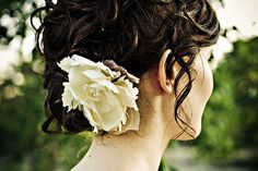 I can't remember where I found this updo but I absolutely love it. Not the flower but the soft curls.