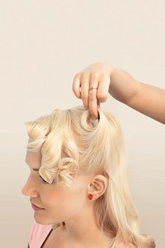 Victory Rolls frame the face and are easy to recreate!
