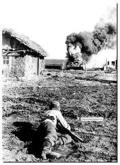 A SS man blows up a Russian T-34 tank during the Battle of Kursk