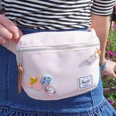 Herschel fanny pack decorated with lots of Disney pins - @abbycorkins on Instagram Walt Disney World // Disney Style // Disney Tee // Disney Outfit // Wear to Disney