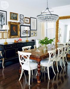 I like the mix of the painted chairs with the antique pine table.