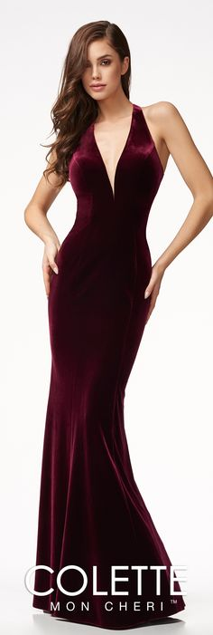 Velvet column silhouette prom dress with a deep V-neckline, a fluted skirt, a fitted bodice, and an open back.