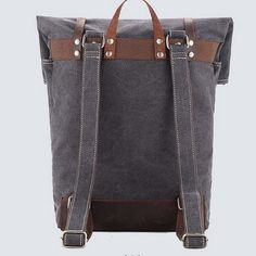 Washed canvas top roll rucksacks with leather straps