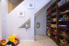 Cool reading/play nook under basement stairs....
