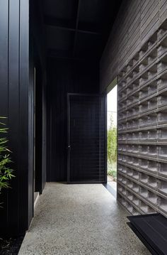 Not so much the concrete blocks, but the vertical cladding and polished concrete--- this could run into timber floors.. Rail House | Clare Cousins Architects