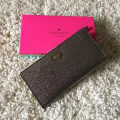 FLASH SALE⚡️Kate Spade Stacy Glitter Bug Wallet Beautiful. Sparkly silver glitter bug Stacy Wallet. 11 credit card slots. Zipper on back. Slots for money and ID slot. I never used this. Cones with tags and box. kate spade Bags Wallets