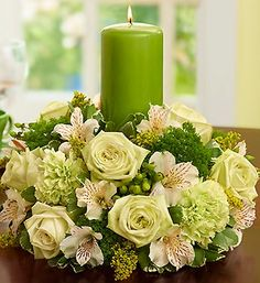 RP: Bring Abundant Peace and Tranquility to the Table: Green Roses, a Traditional Symbol of Calm, Prosperity and Good luck, Enhanced by the Elegance of the Green Pillar Candle Candle Centerpieces, Floral Centerpieces, Pillar Candles, Floral Arrangements, Centerpiece Ideas, Beautiful Candles, Beautiful Flowers, Green Carnation, Anniversary Flowers