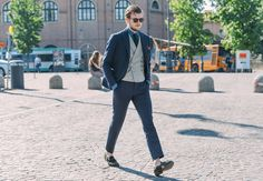 GQ. Street Style: Tommy Ton Shoots Pitti Uomo  Our street shooting man spots the standout sartorial efforts outside Florence's menswear tradeshow mecca   PHOTOGRAPHS BY TOMMY TON June 19, 2014