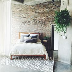 Great exposed brick loft w/ west elm's Mid-Century Bed + Marquis Rug + more!