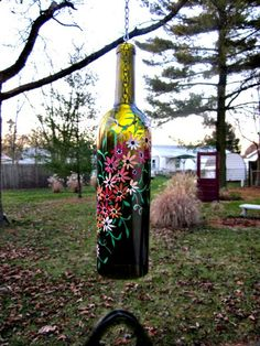 Painted wine bottles!  Could be a super fun project (like you totally need more projects...hahaha)