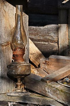 The lamp has gone out forever in this rustic abandoned cabin. Just waiting to gather cobwebs. Old Lanterns, Lampe Decoration, Antique Oil Lamps, Kerosene Lamp, Lantern Lamp, Le Far West, Old Barns, Cabins In The Woods, Rustic Charm