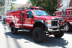 """Block has just unveiled the badass Ford RaptorTrax -- a tracked and supercharged Ford Raptor designed to be the ultimate """"mountain assault vehicle. Cool Trucks, Big Trucks, Ambulance, Rescue Vehicles, Ford Vehicles, Police Vehicles, Radios, Brush Truck, Wildland Firefighter"""