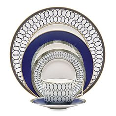 Transform your meal into a royal affair with the opulent Wedgwood® Renaissance Gold Dinnerware. Reminiscent of Europe's Renaissance period, the dinnerware is embellished with a whimsical dragon motif and oval link patterns in blue and gold.