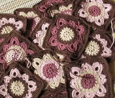 Chocolate brown and powder pink are great colors together. Looks like someone worked up multiple #crochet squares. For an afghan maybe?
