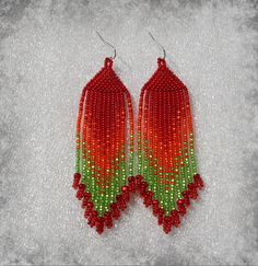 Beautiful beaded dangle peyote earrings with fringe.Native American style, Boho style. Earrings made from Czech beads. Surgical Steel ear wires.. Measurements: Length - 10.5 cm (including ear wires) Width - 2.5 cm more earrings here http://www.etsy.com/shop/Olisava?section_id=14128476
