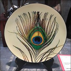Nothing is fancier than Peacock Feathers … except maybe live Peacocks strutting and calling. Here Littman Jewelers uses them to decorate a side table at one of their Diamond Parties offering in-sto…