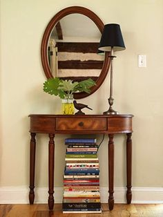 Use an artful stack of books to hide unsightly things like cords or your router. | 24 Creative Ways To Decorate Your Place For Free