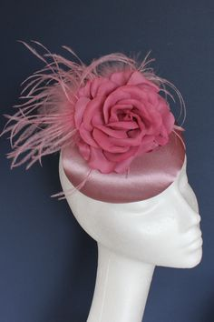 Pink satin base with an overblown pink rose and feather detailing. Small hat perfect for a wedding guest or day at the races. Race Day, Pink Satin, Hats For Women, Feather, Gloves, College, Base, Button, Wedding