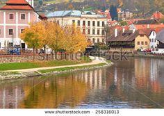 Old traditional buildings on both banks of Vltava river in autumn, Cesky Krumlov, Czech Republic - stock photo