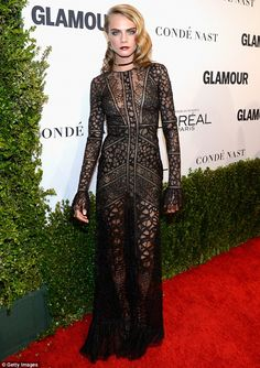 Mesmerizing woman:Cara Delevingne stunned in a sheer black gown with flared sleeves and l...
