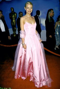 I'm sorry but, POOR FITTING BODICE! Gwyneth Paltrow Ralph Lauren designed this pink taffeta gown for Paltrow's 1999 appearance at the Oscars, where she took home a Best Actress trophy for her work in Shakespeare in Love.