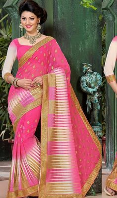 Flaunt your glamorous grace clad in this pink embroidered chiffon sari. The attractive lace, resham and stones work a substantial attribute of this attire. #FancyLaceWorkPinkAndWhiteSari