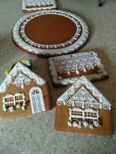 Gingerbread house parts and base beautifully decorated, ready to assemble