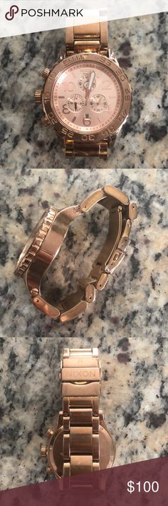 Women's rose gold Nixon watch Women's Nixon Watch, retails for $540.  Some wear to the links, some have small scratches, would look great cleaned up! Needs new batteries. I have a 6.5 in wrist and it moves around freely but fits well. Can take links out if need be. Nixon Accessories Watches