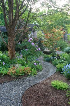 Winding gravel path. Curving paths can make a small garden feel larger. Enhance this space-expanding effect by using smaller plants in the foreground and taller, fuller plants and trees near the back of your path.