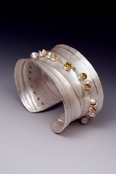 Idea using handmade rivets as part of the design - not just to hold things together - Liaung-Chung Yen » Bracelets