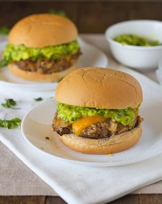 These southwest chipotle burgers have smoky chipotle flavor and crushed tortilla chips right in the burgers. Topped with guacamole - perfect!