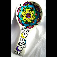 Colorful mandala spoon rest   https://www.etsy.com/listing/214597723/painted-mandala-style-spoon-rest